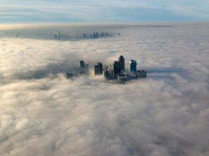 The Canary Wharf financial district and central London emerge from morning fog in this aerial photograph released by the Metropolitan Police in London