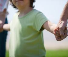 153348398-boy-holding-hands-with-parents-cropped-gettyimages-401x337