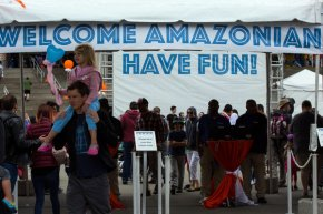 Amazon employees and family members attending a company picnic. Some fathers at Amazon said they considered quitting because of pressure from bosses to spend less time with their families.