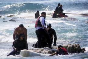 Migrants, who are trying to reach Greece, are rescued by members of the Greek Coast guard and locals near the coast of the southeastern island of Rhodes April 20, 2015. A wooden sailboat carrying dozens of immigrants ran aground on Monday off the coast of the Greek island of Rhodes and at least three people have drowned, the Greek coast guard said. REUTERS/Argiris Mantikos/Eurokinissi      TPX IMAGES OF THE DAY     GREECE OUT. NO COMMERCIAL OR EDITORIAL SALES IN GREECENO SALES NO ARCHIVES